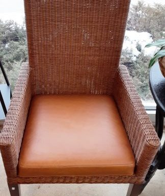 2-Rattan and Leather Arm Chairs Priced Separate